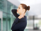 Business woman with back and neck pain